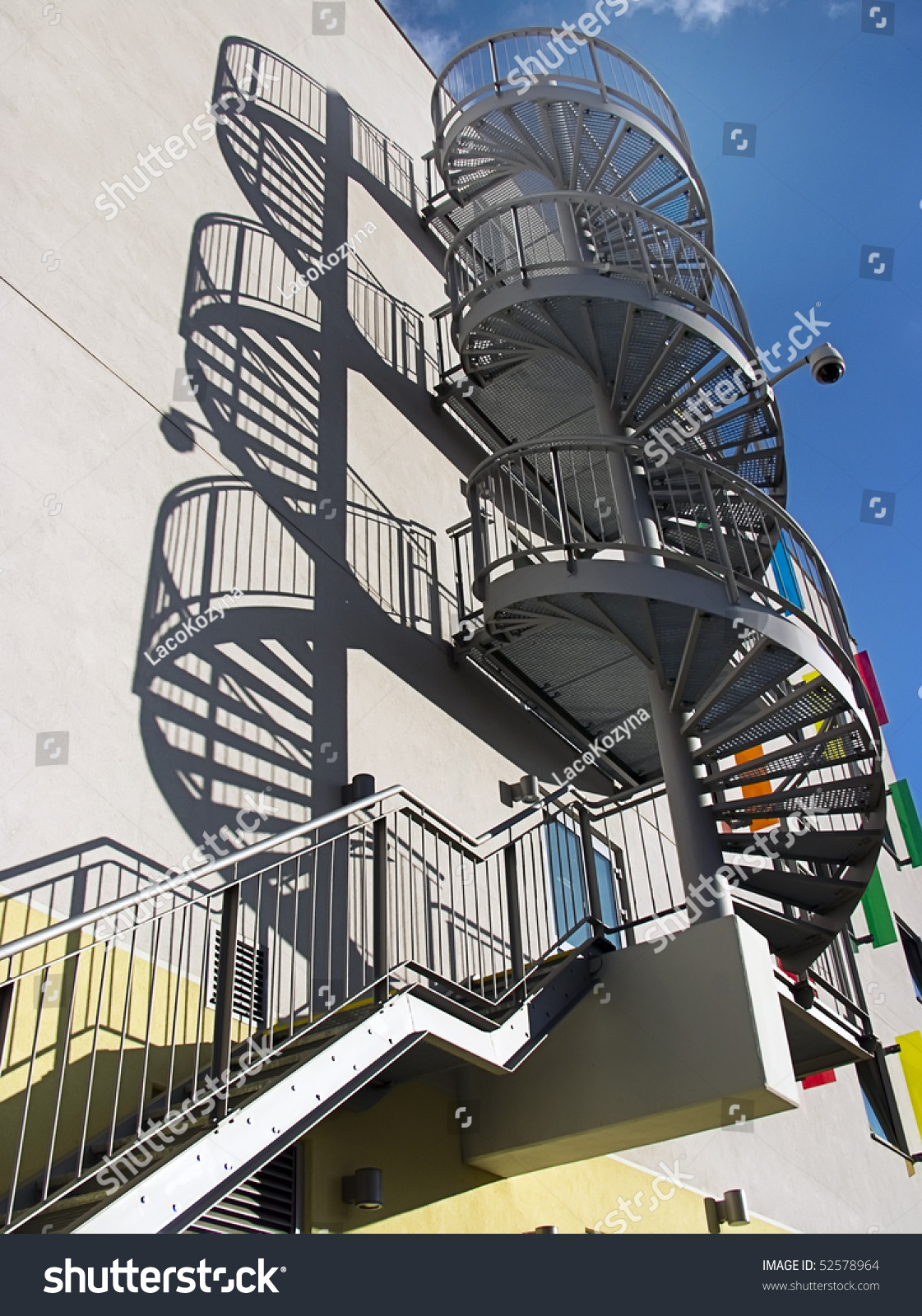 Modern spiral metal staircase on building stock photo for Aluminum spiral staircase prices