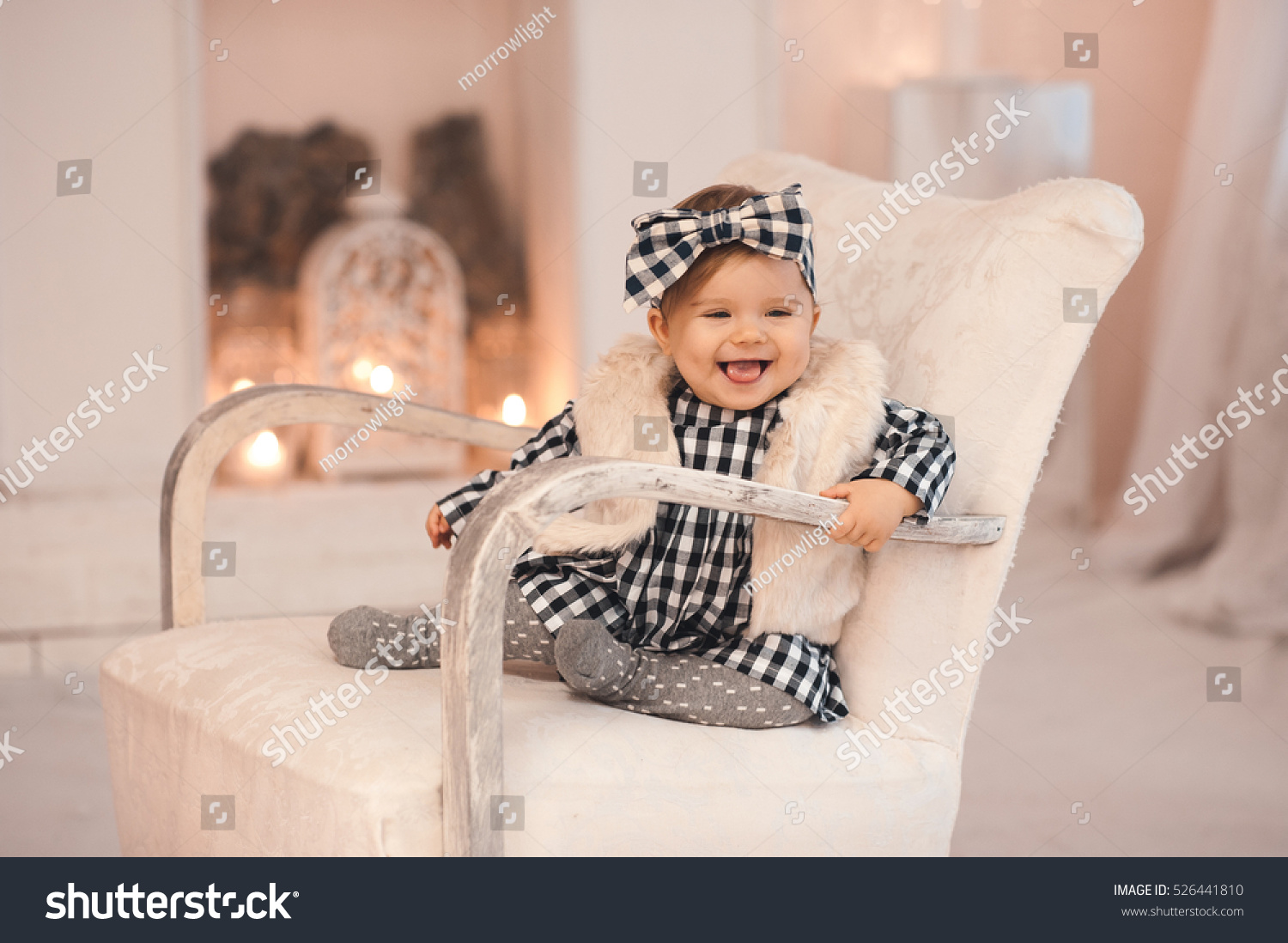 Black child sitting in chair - Smiling Baby Girl Under 1 Year Old Wearing Stylish Clothes Sitting In Vintage Chair Over White