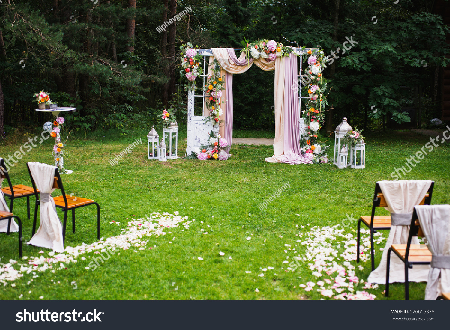 beautiful wedding ceremony outdoors decorated chairs stock photo