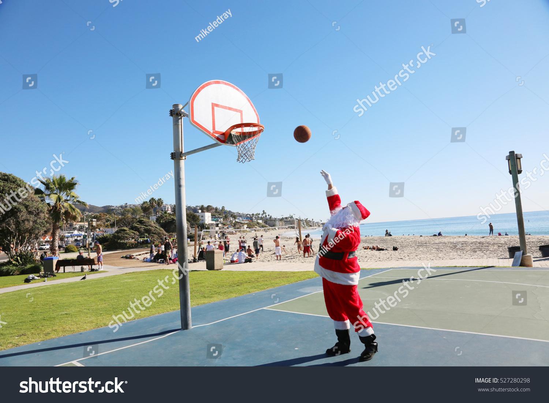 Santa claus plays basket ball outside stock photo