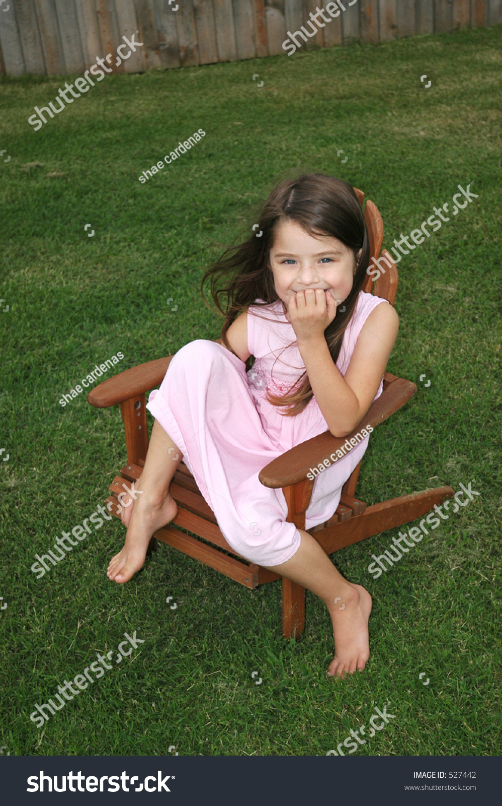 Little Girl Sitting Lawn Chair Laughing Stock Photo 527442