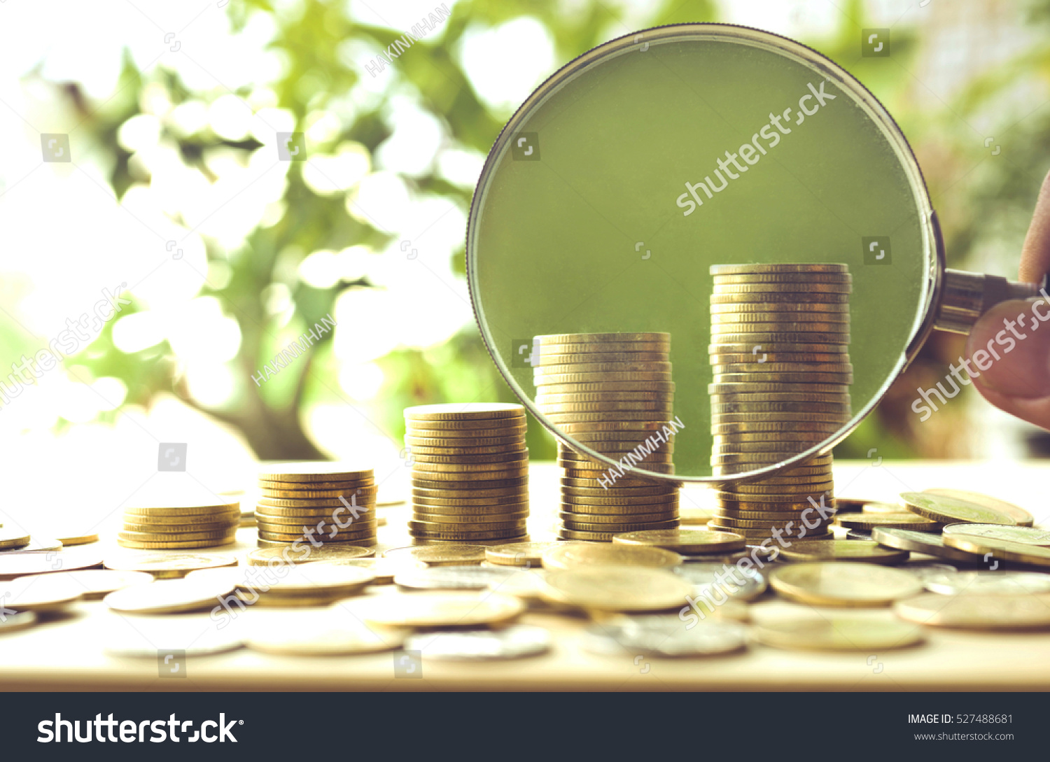 Hand Magnifying Glass Money Coins Stack Stock Photo - Artist creates art power sunlight magnifying glass