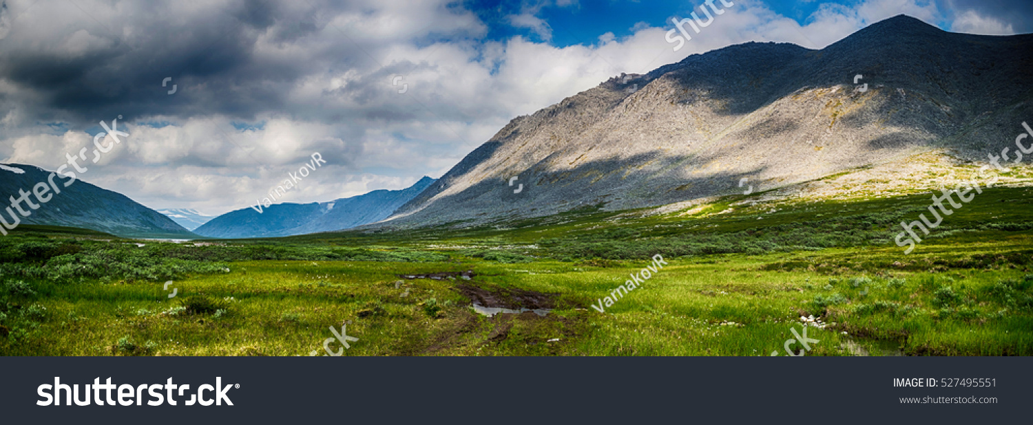 stock-photo-meadow-in-front-of-ural-moun