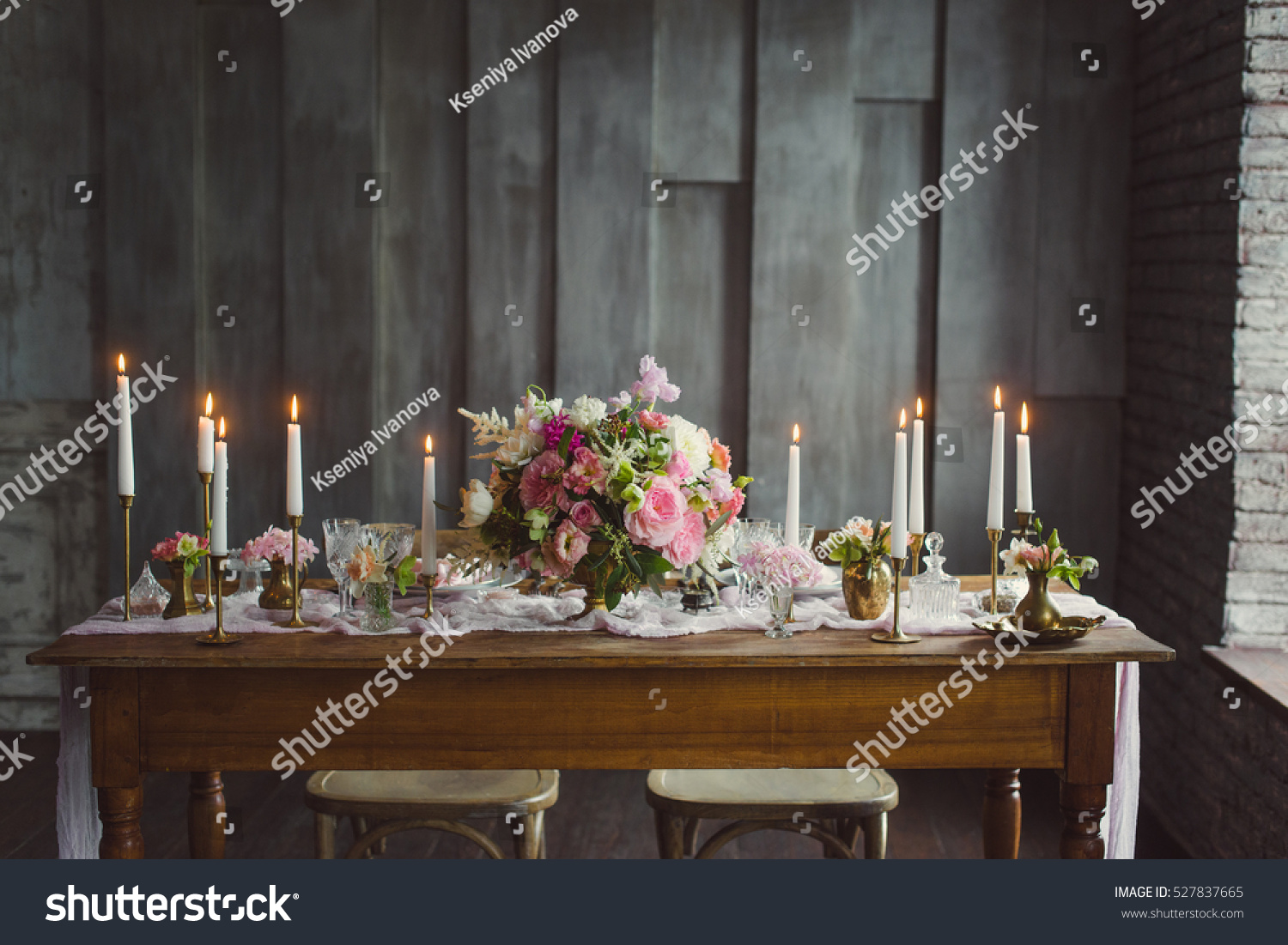 Wedding decoration candles on table decor stock photo 527837665 wedding decoration candles on the table with decor and a bouquet of pink and white junglespirit Image collections