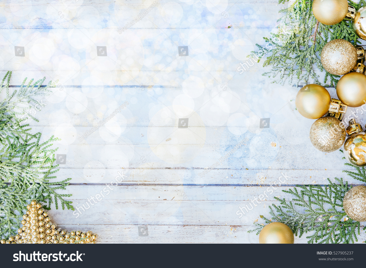 Christmas decoration Golden balls star and fir tree branches on the white snowy wooden background New year greeting card template Holiday mock up Scandinavian style