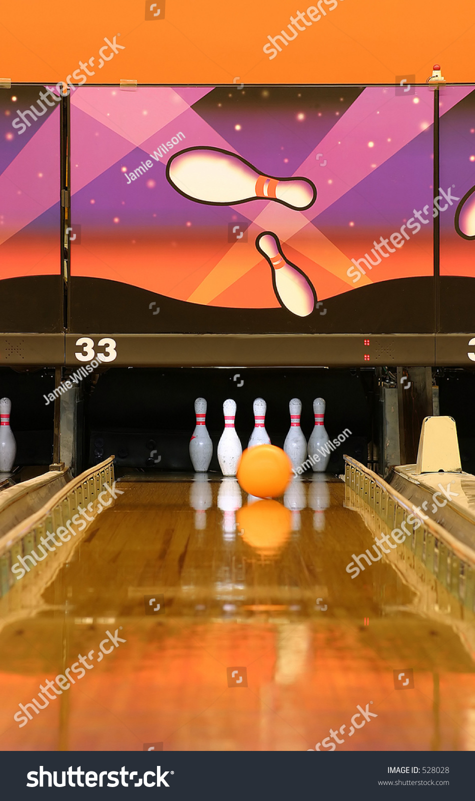 A Bowling Alley Gutter Guards Are Up And Ball Is Heading
