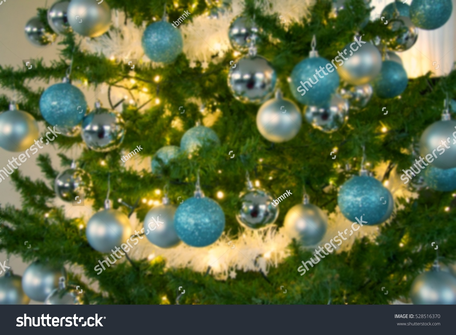 traditional decorated christmas tree in green colors with green and blue balls blurred background close up ez canvas - Green Christmas Tree With Blue Decorations
