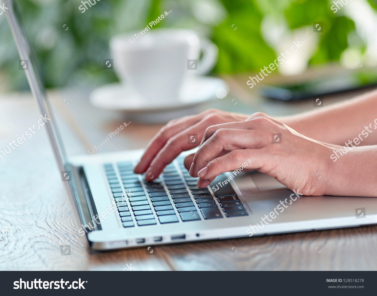 Woman working on her laptop computer Working on laptop at home or office concept Shallow DOF