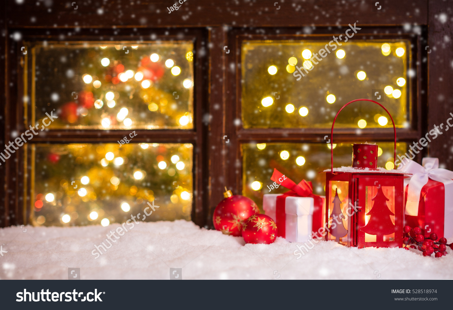 atmospheric christmas window sill with decoration and blur tree wth lights inside