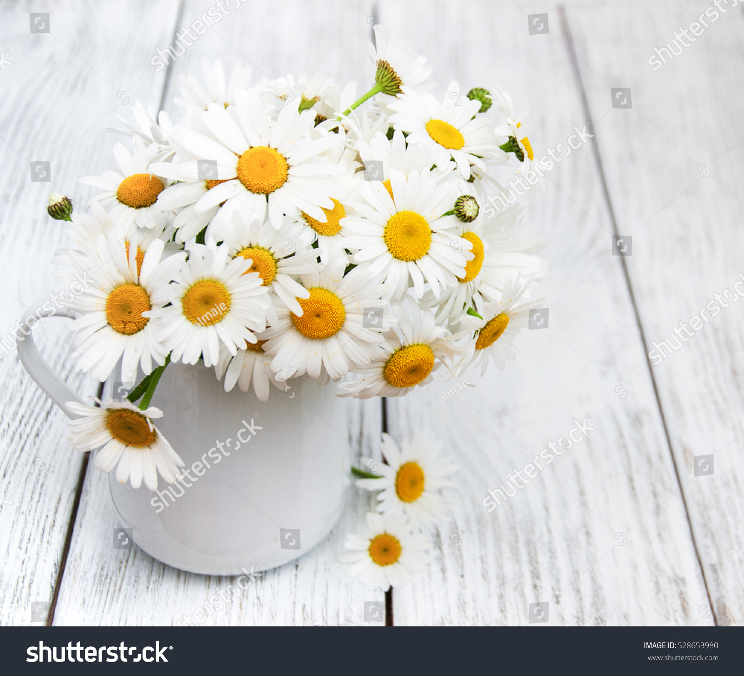 Daisies vase on old wooden table stock photo 528653980 shutterstock daisies in vase on a old wooden table reviewsmspy