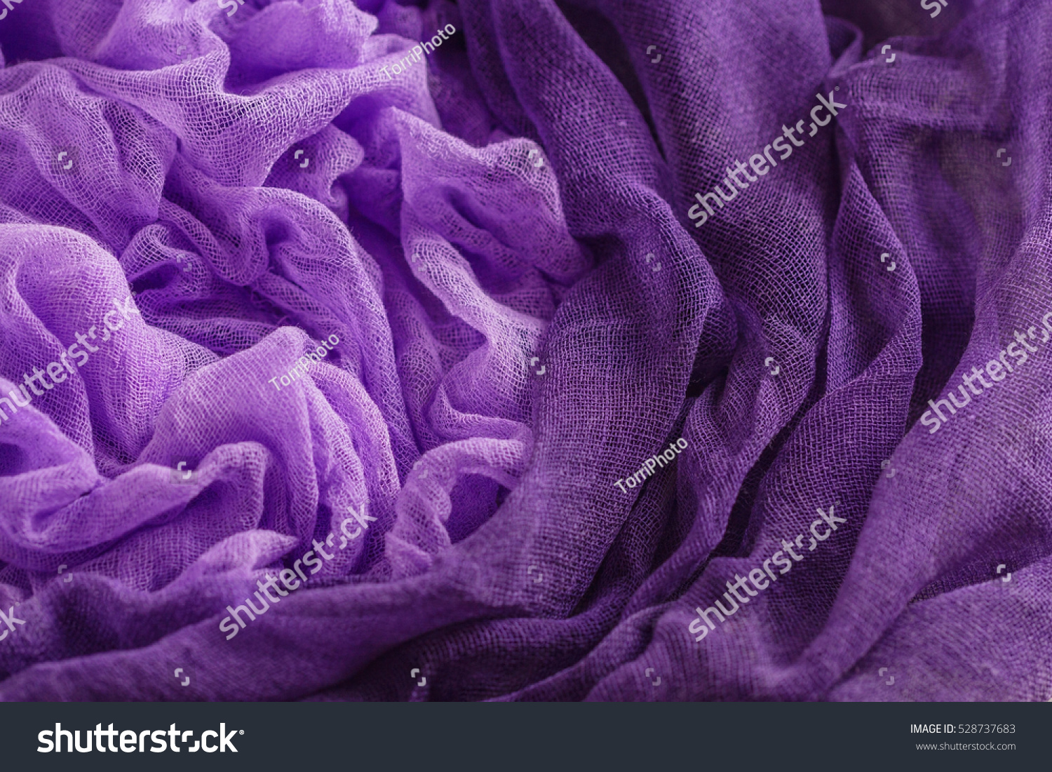 https://www.shutterstock.com/pic-528737683/stock-photo-hand-dyed-gauze-fabric-purple-color-colorful-cloth-texture-background.html