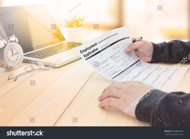 Businessman job seeker fill employment application stock photo businessman or job seeker fill in employment application form with pen to get a new job falaconquin