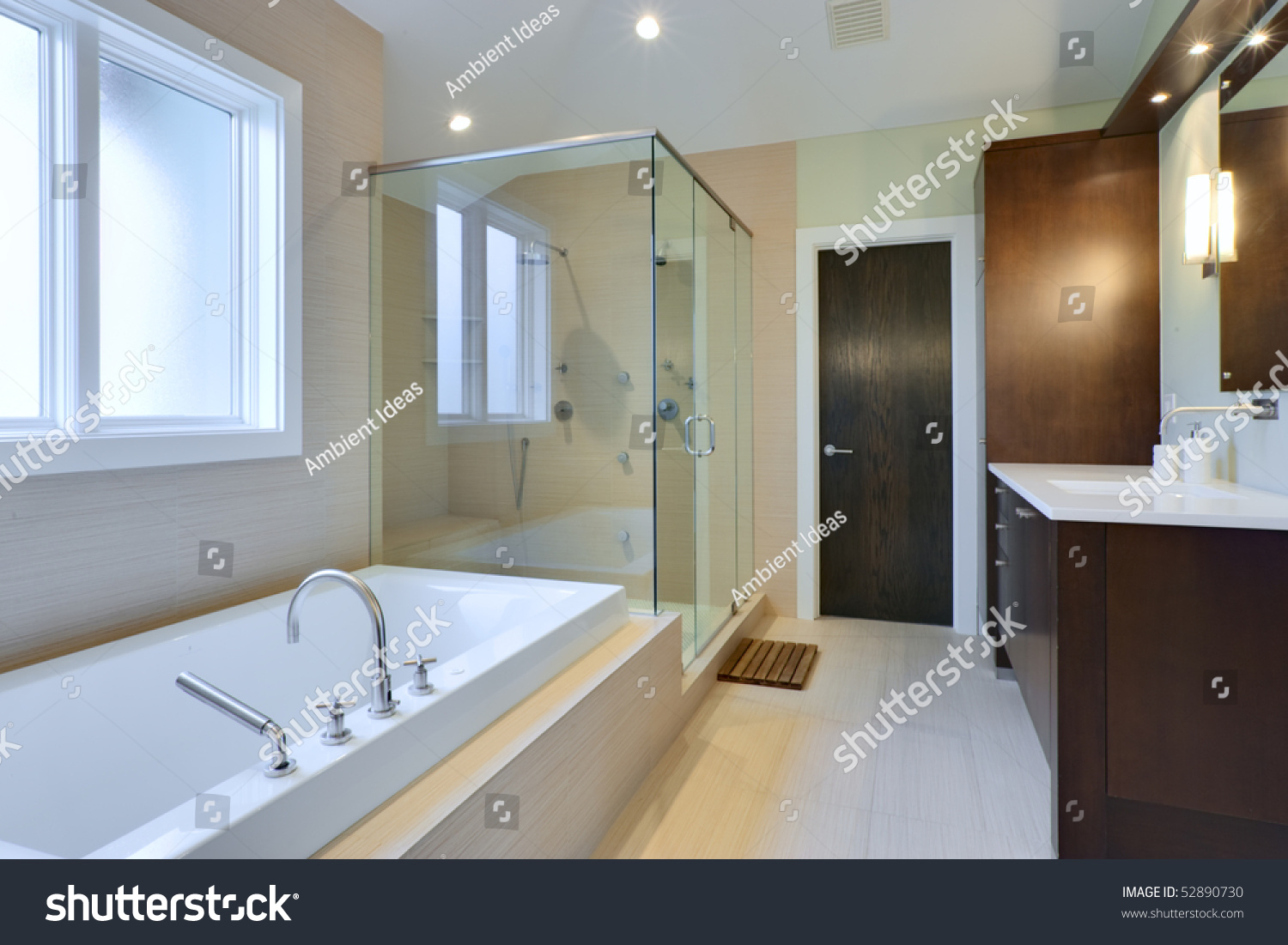 luxury master bath with glass shower and large bath tub stock photo