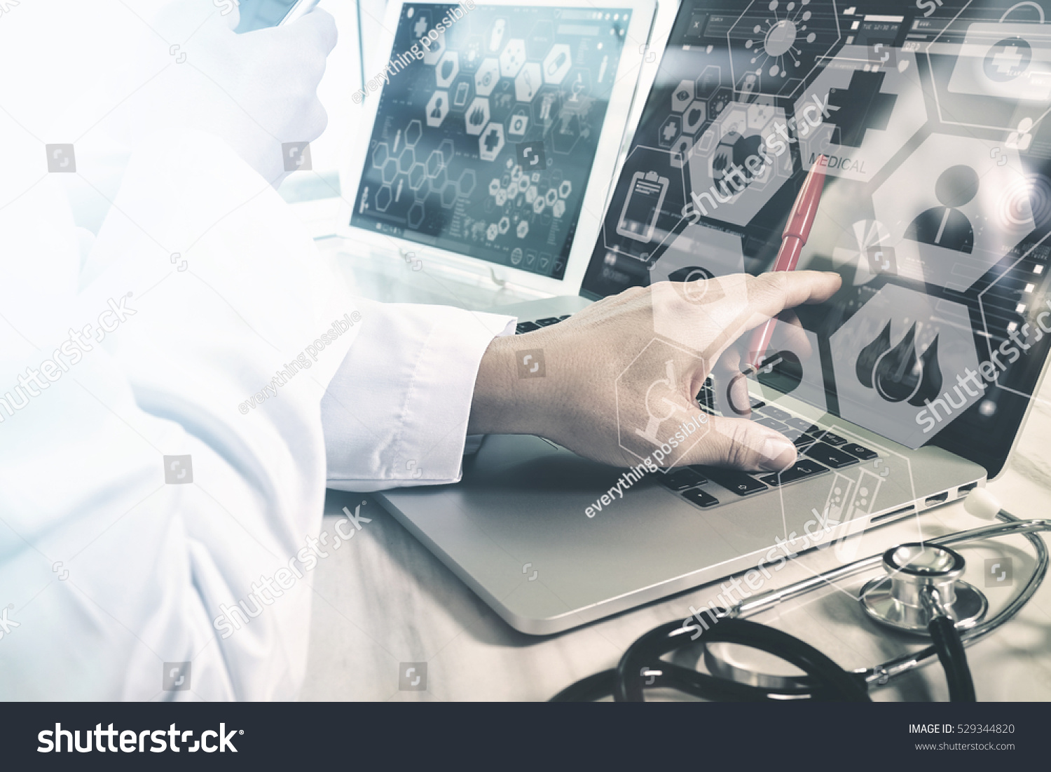 Medical technology concept Doctor hand working with modern smart phone with chart interface multi-channel connection network hospital