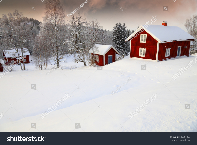 Winter Landscape With Old Rural Cottages In Sweden