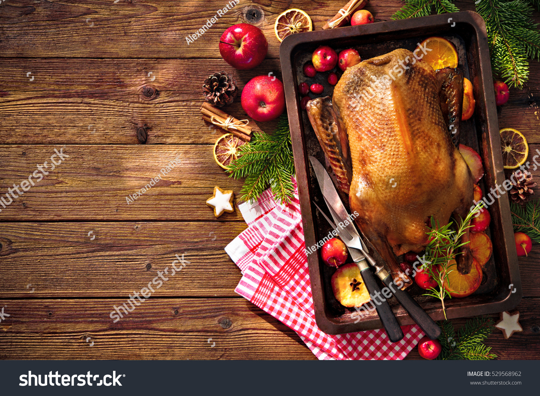 Roast duck apples oranges on baking stock photo 529568962 for Baking oranges for christmas decoration