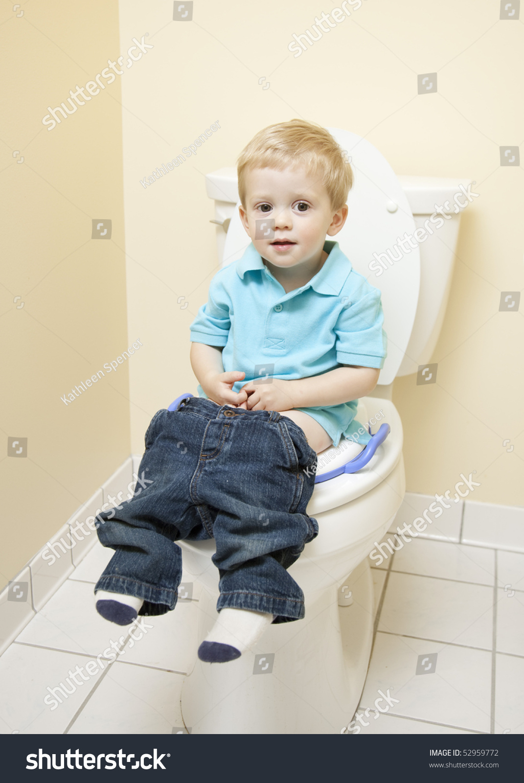 young boy and the toilets Young Boy Sitting on Toilet Seat