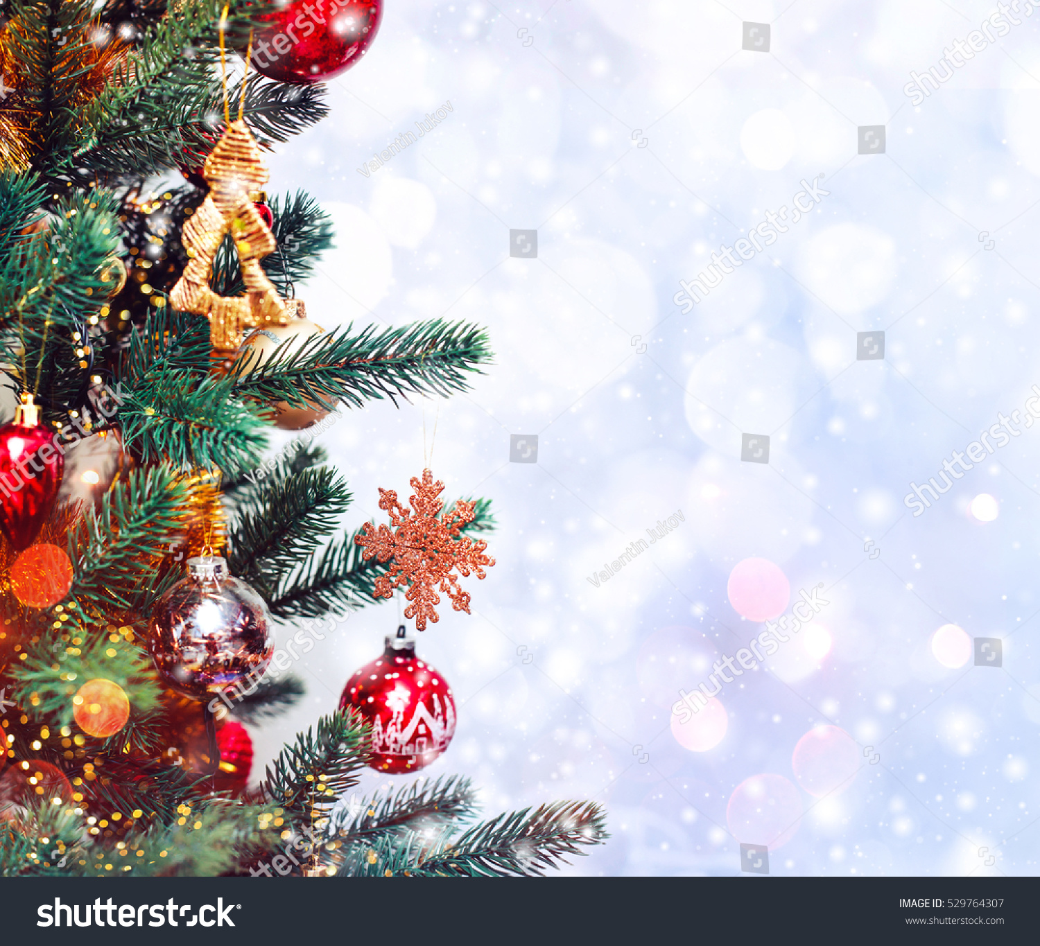 christmas tree background and christmas decorations with snow blurred sparking glowing happy