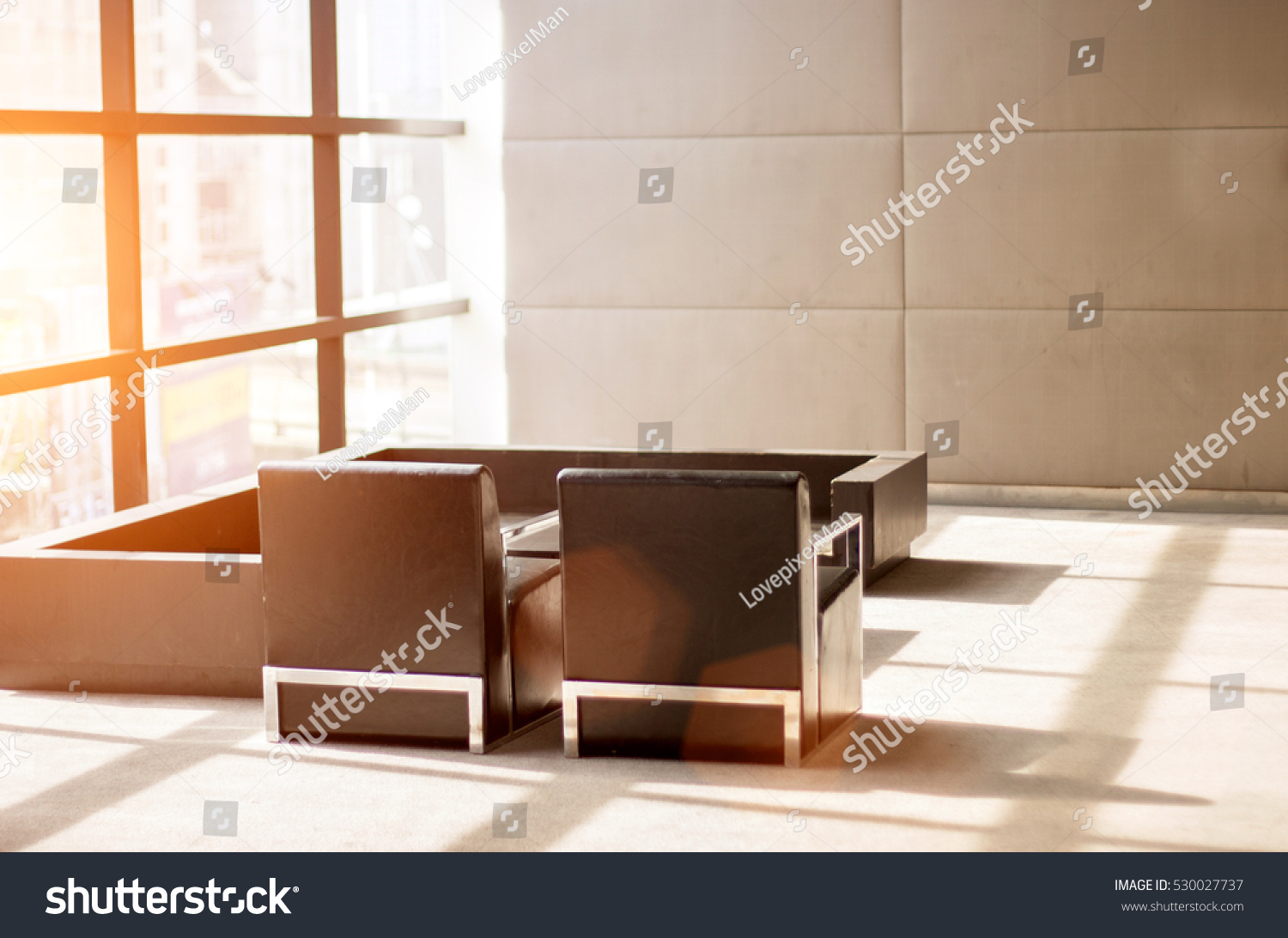 Modern interior meeting room in warm morning light with lens flare for background