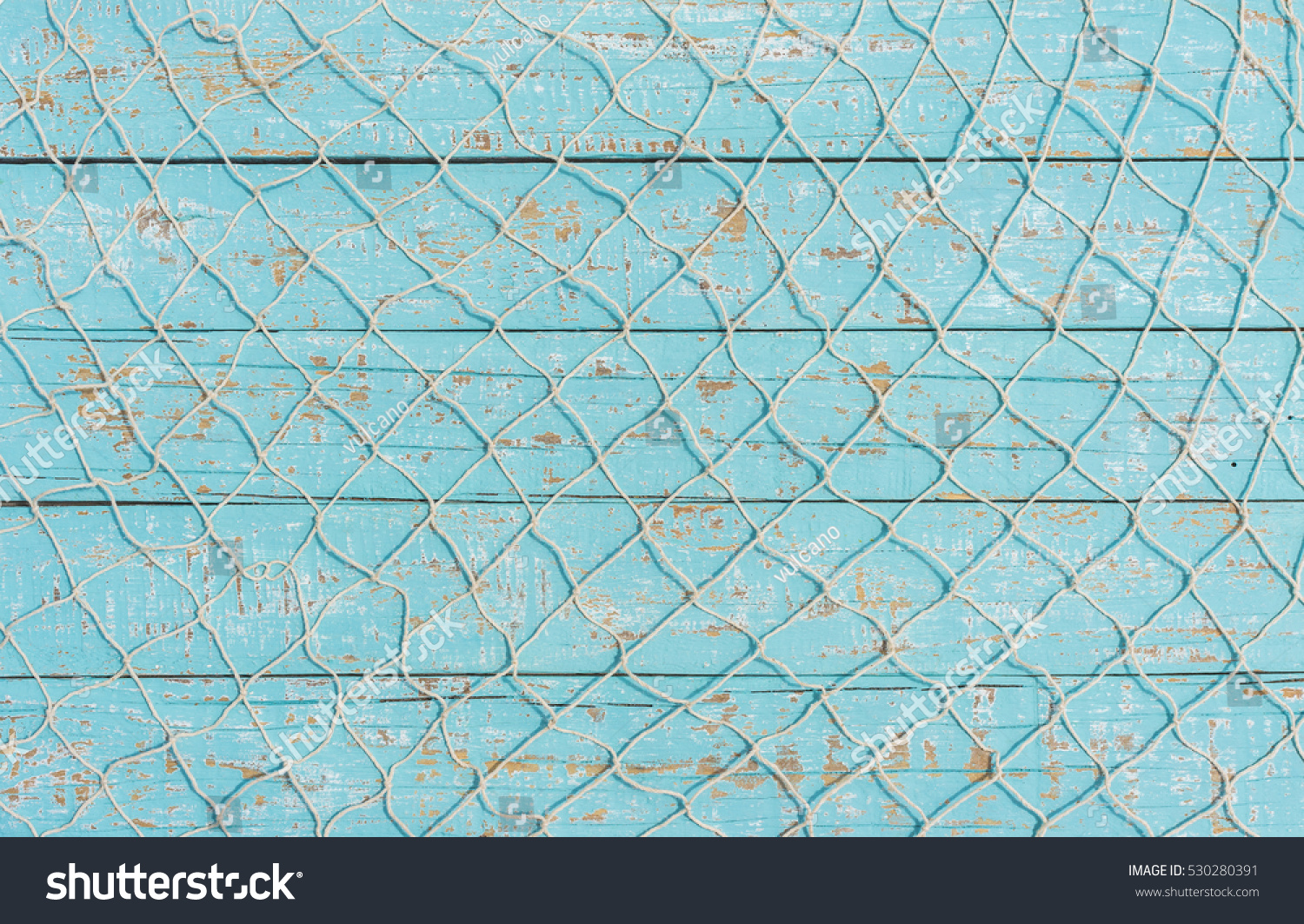 Maritime nautical fishing net texture on turquoise blue wood background, copy space.  #530280391