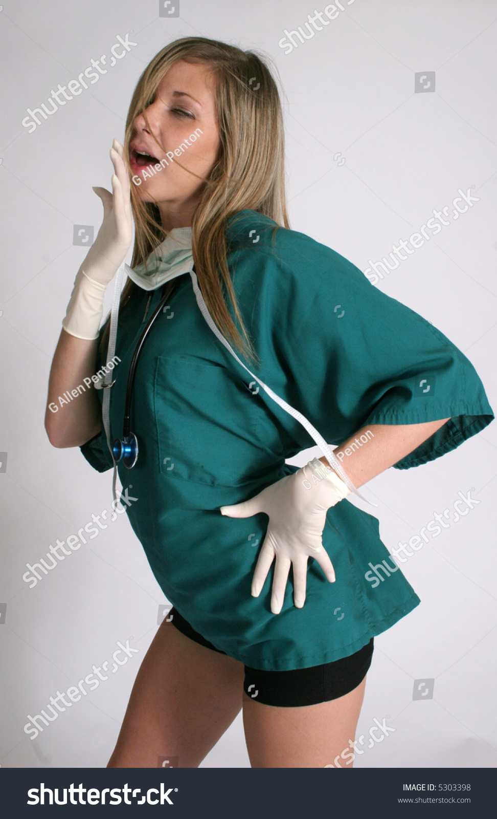 Sexy nurse wearing gloves