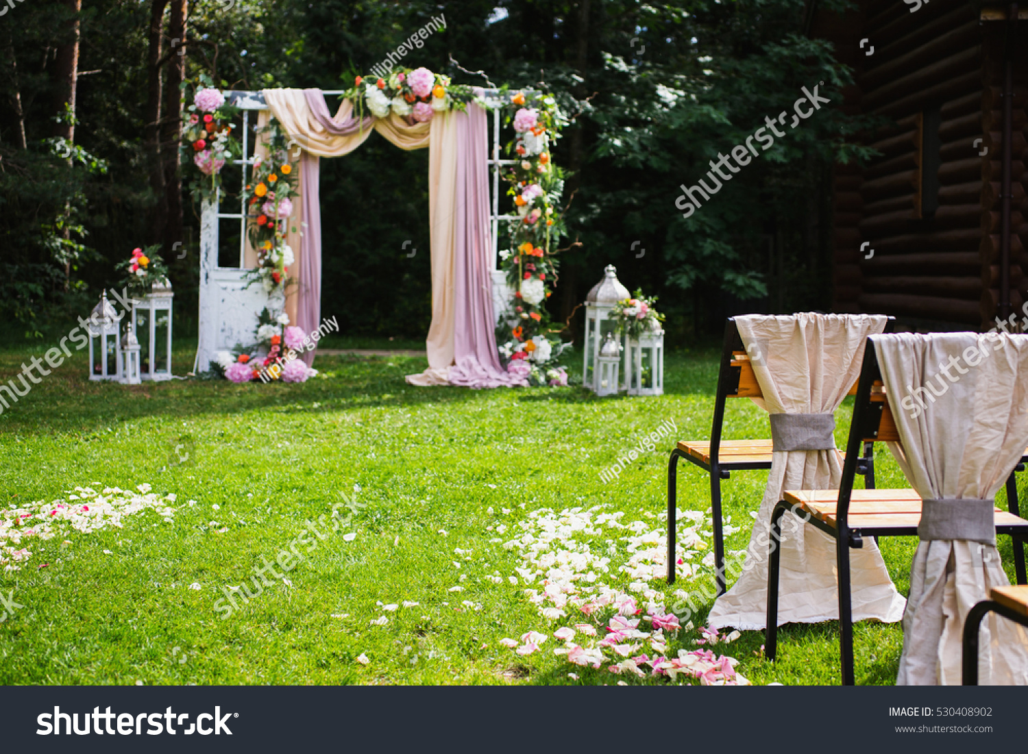 Wedding ceremony chair - Beautiful Wedding Ceremony Outdoors Decorated Chairs Stand On The Grass Wedding Arch Made Of
