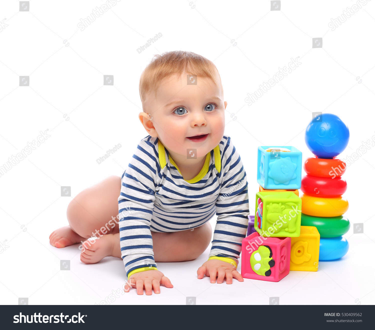 cute babe plays toys stock photo (safe to use) 530409562 - shutterstock