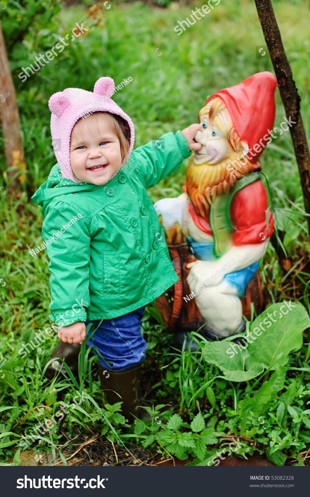 Girl Holding The Nose Of Garden Gnome