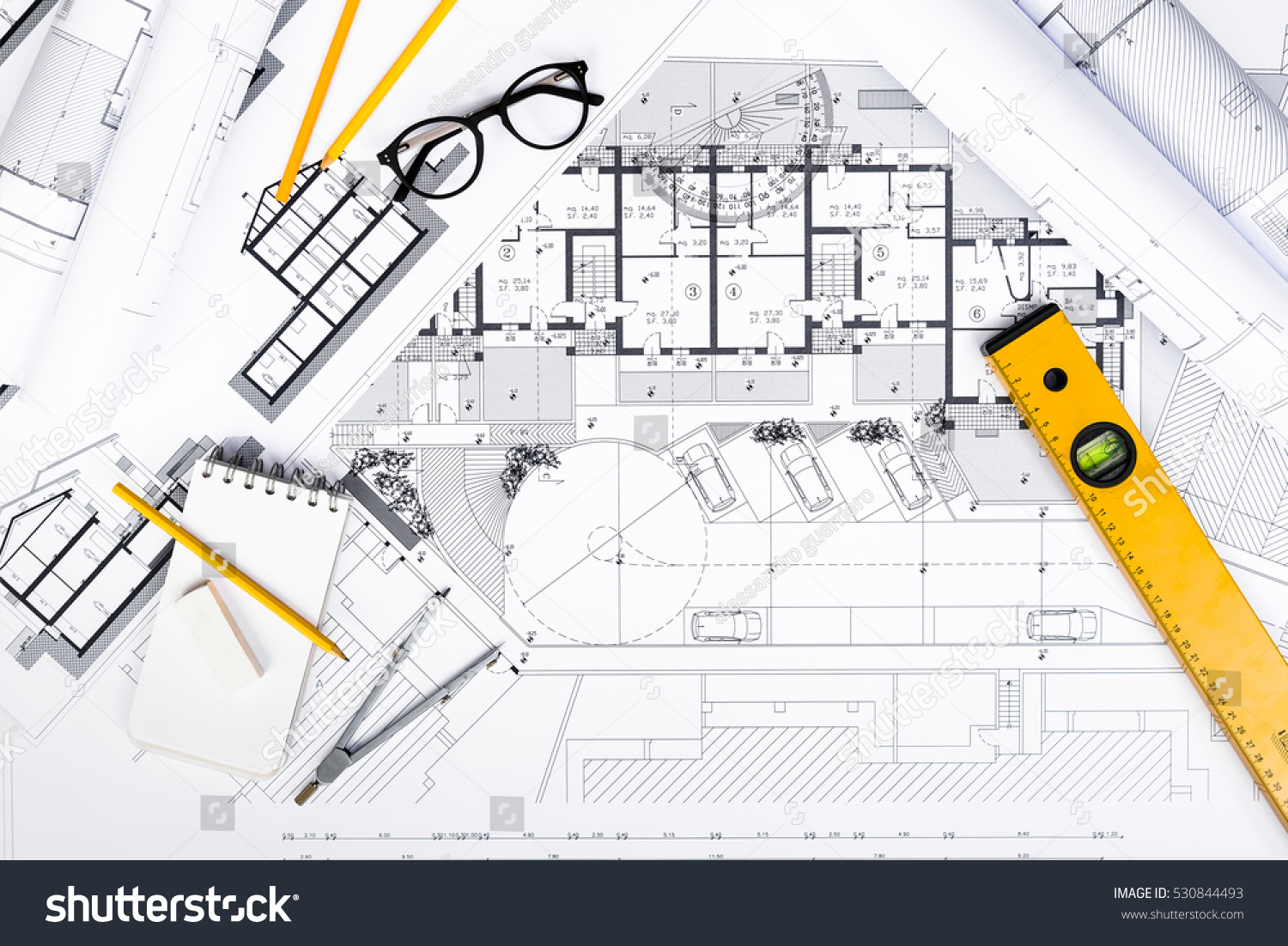 Top view construction plans tablet drawing stock photo for Architectural engineering concepts