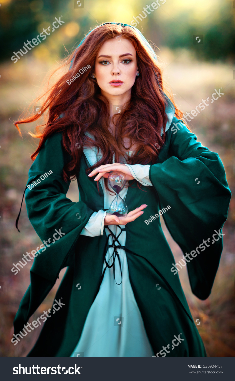 Beautiful Red Haired Girl In Green Stock Photo 530904457