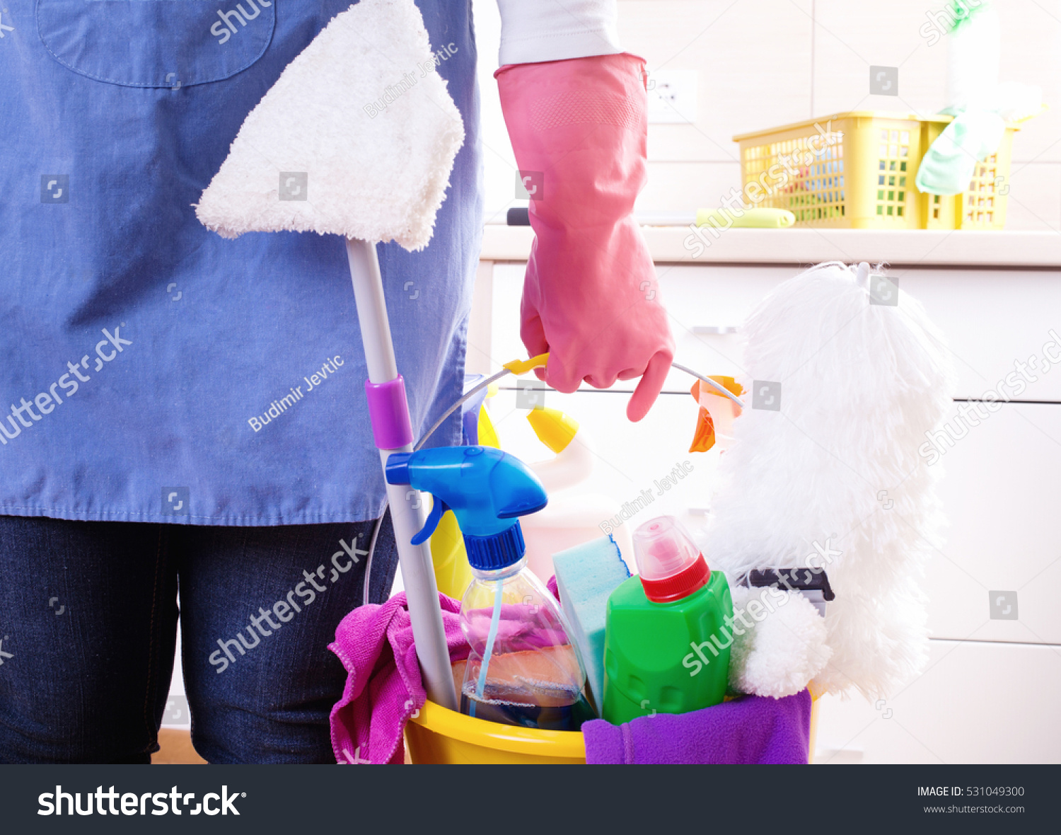 White gloves apron cleaning services - House Keeper With Apron And Safety Gloves Holding Basket Full Of Cleaning Supplies And Equipment In