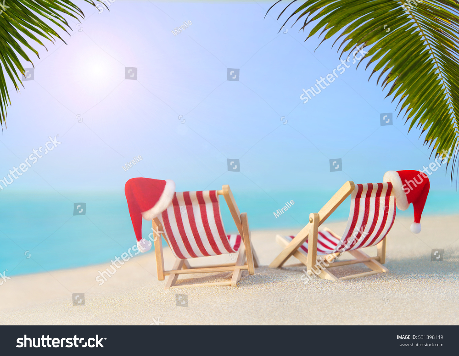 Royalty free two striped red white sunloungers with for Hot vacation spots for couples