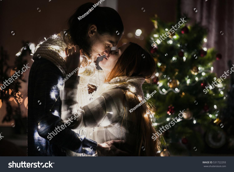 Young Couple Celebrating Christmas Home Kiss Stock Photo (Edit Now ...