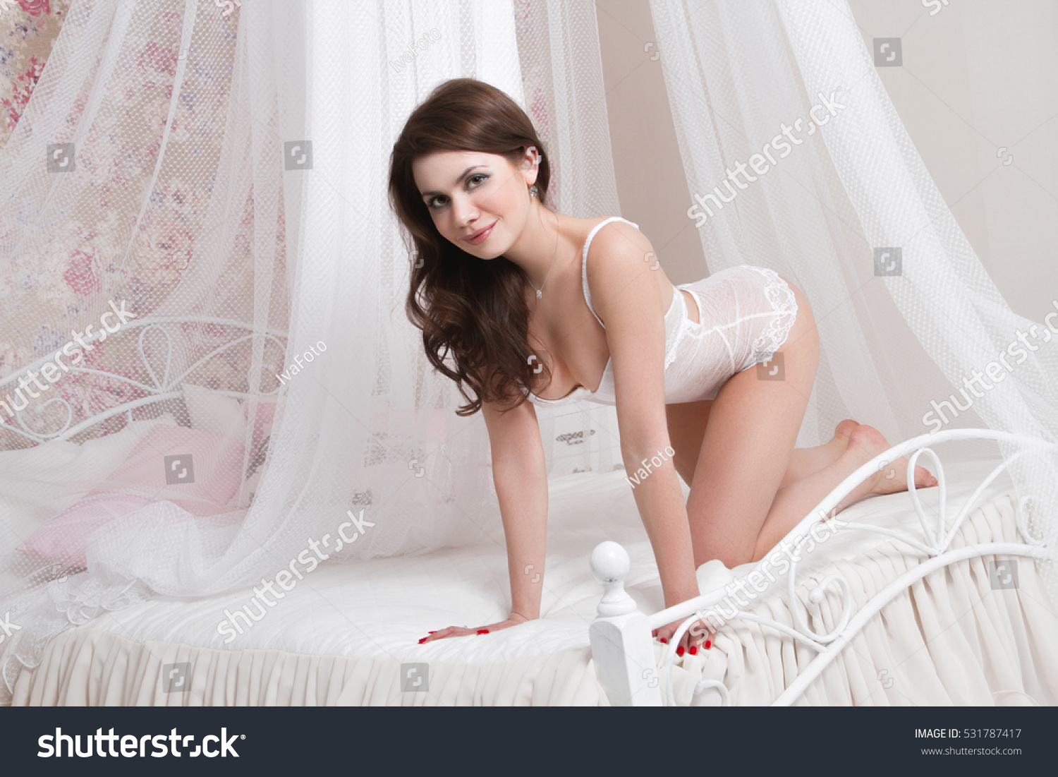 beautiful sexy brunette big breasts sitting stock photo (royalty