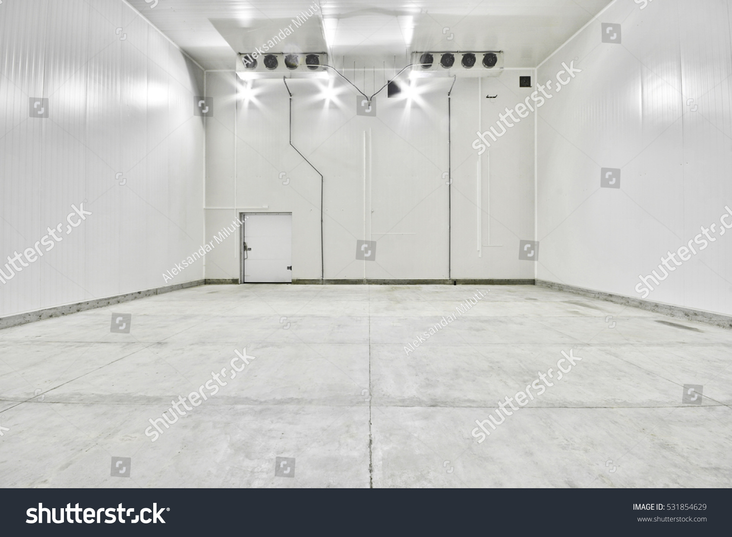 An Empty Industrial Room Refrigerator With Eight Fans