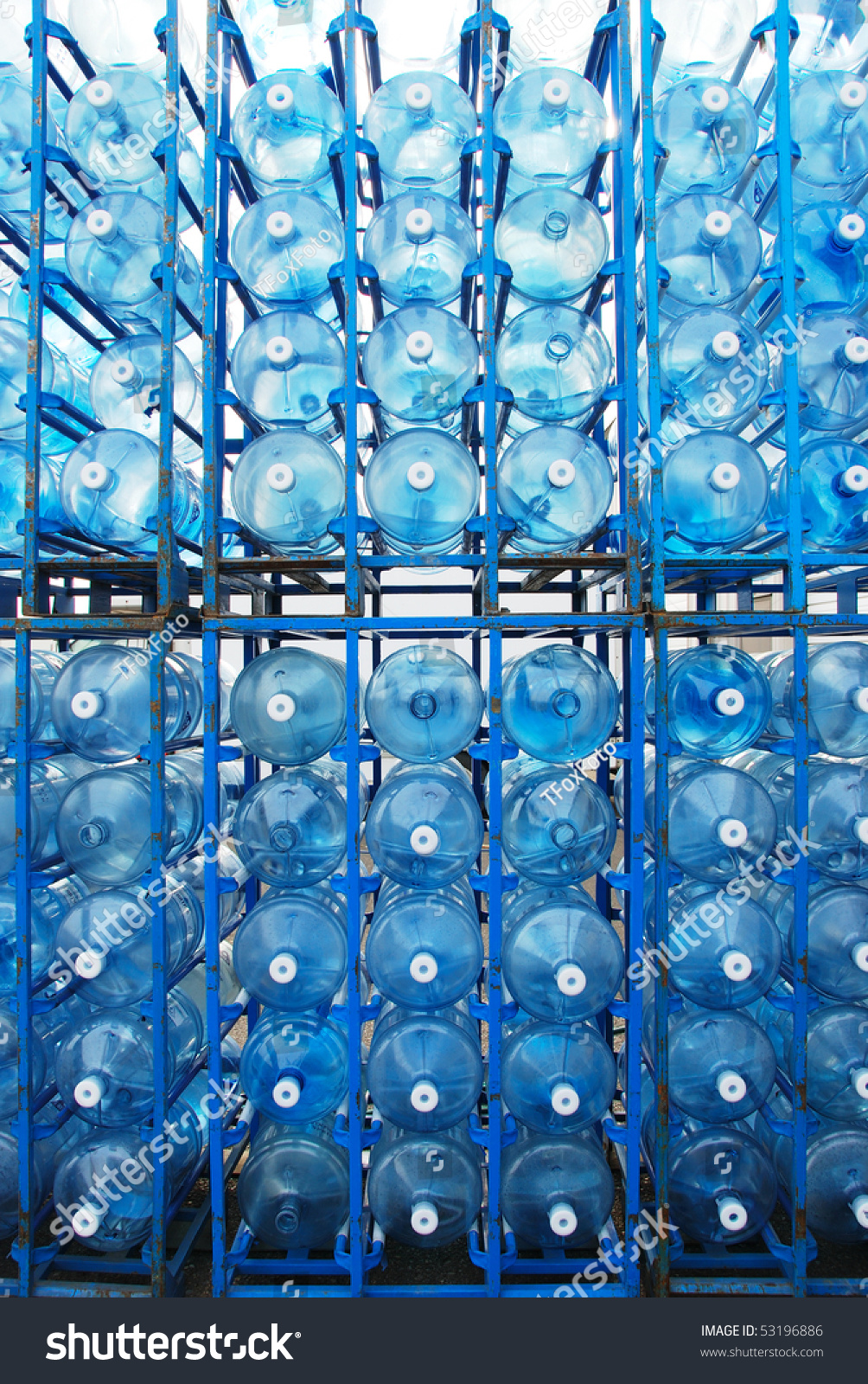 5 Gallon Plastic Water Bottles Awaiting Stock Photo