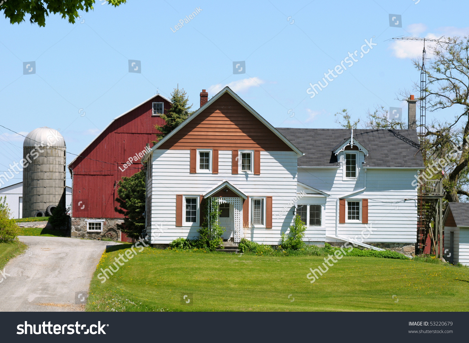 Farm house with a red barn silo and tv antenna stock for Red barn houses