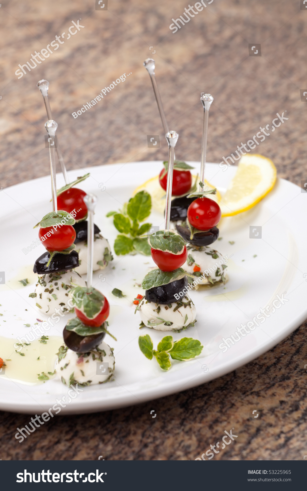 Plate full of delicious mozzarella cheese canape for Canape sandwiches