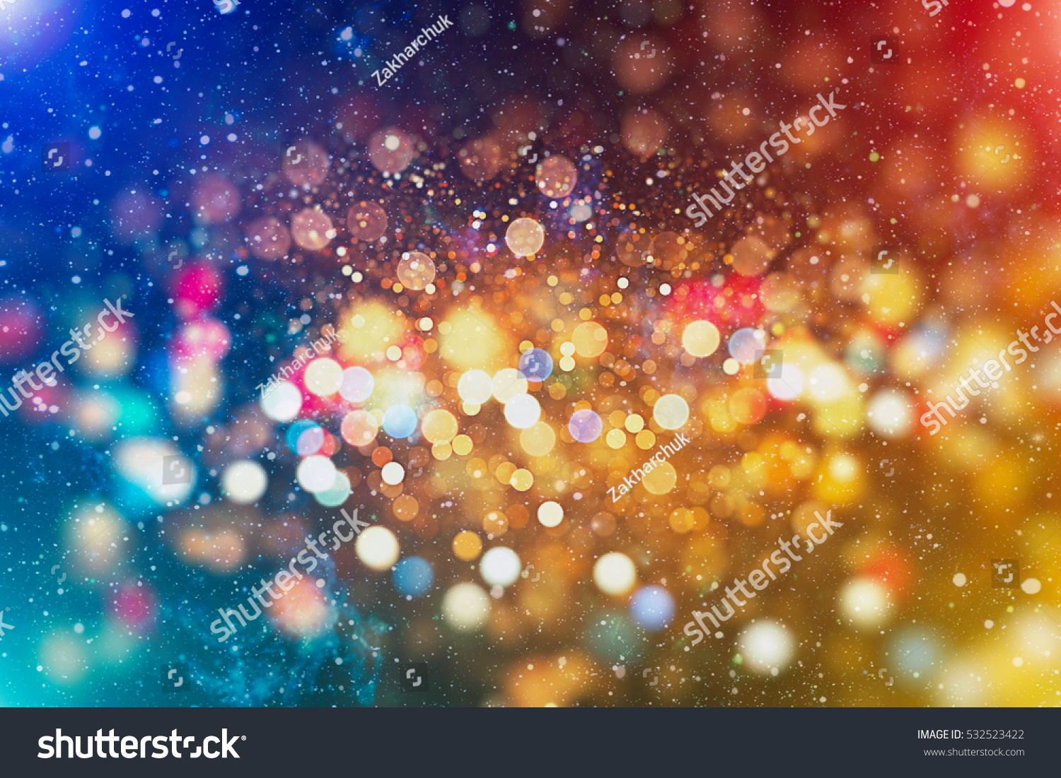 abstract blurred of blue and silver glittering shine bulbs lights background:blur of Christmas wallpaper decorations concept.xmas holiday festival backdrop:sparkle circle lit celebrations display .