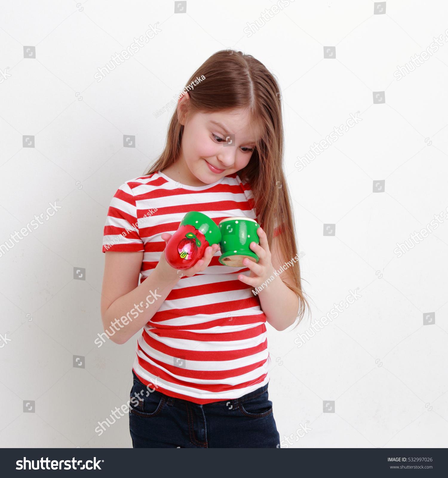 Beautiful russian teen girl holding matryoshka