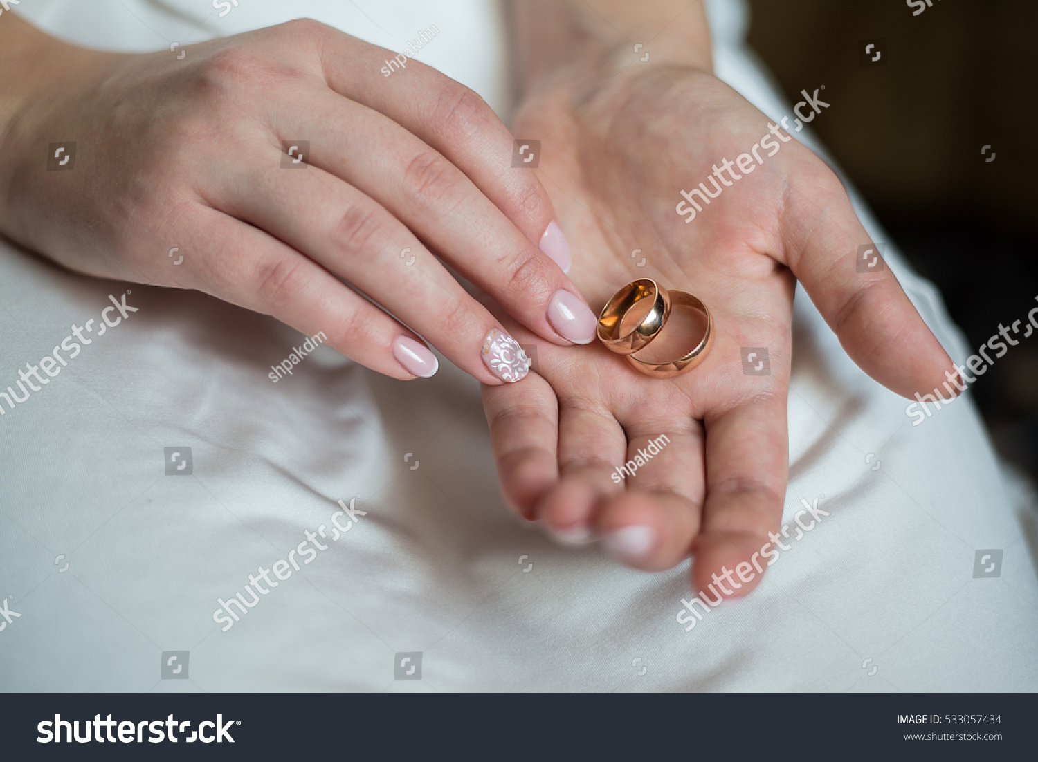 Bride holding her engagement ring. | EZ Canvas