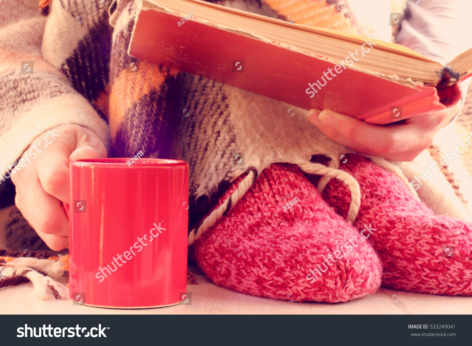 red book a cup and socks in cozy warming home environment self on winter vacation
