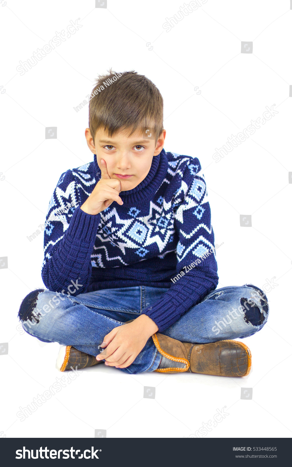 Happy little boy in warm sweater and… Stock Photo 533448565