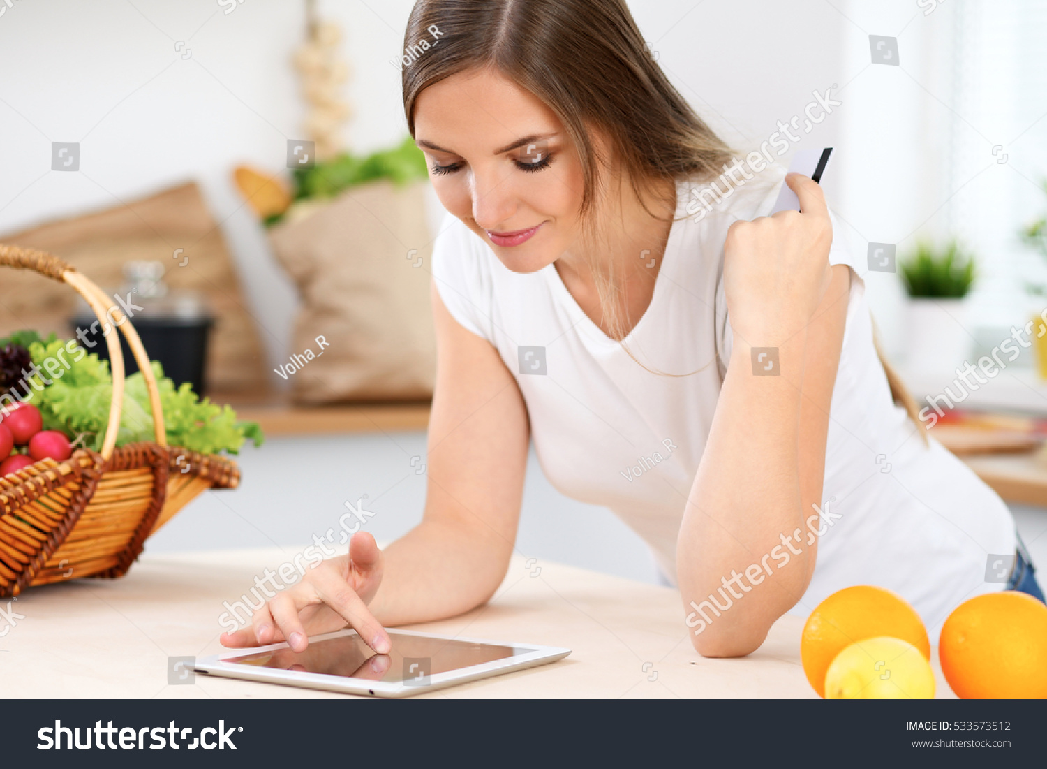 young woman making online shopping by stock photo royalty free