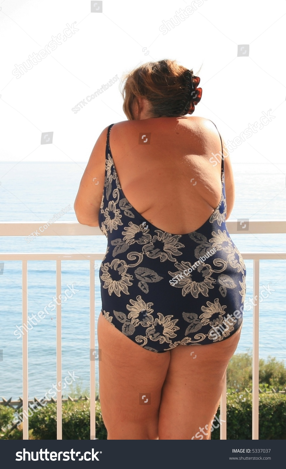 Obese girl in bathing suit entertaining
