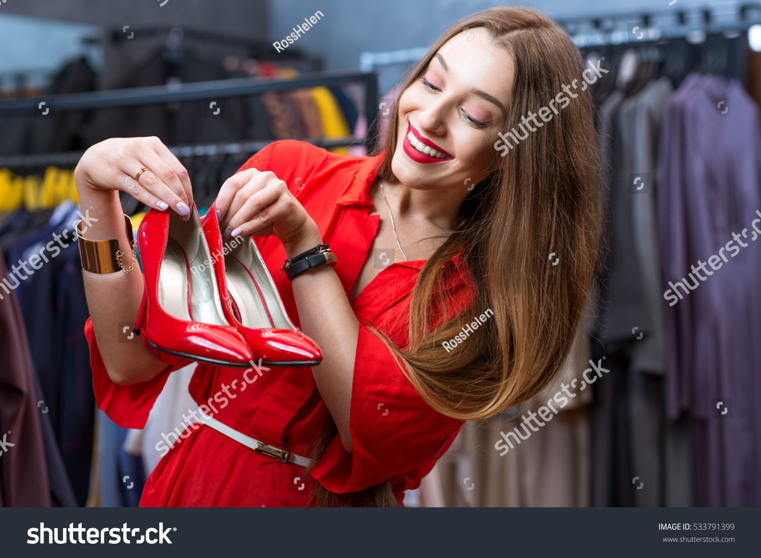 Young Woman Red Dress Choosing Shoes Stock Photo 533791399 ...