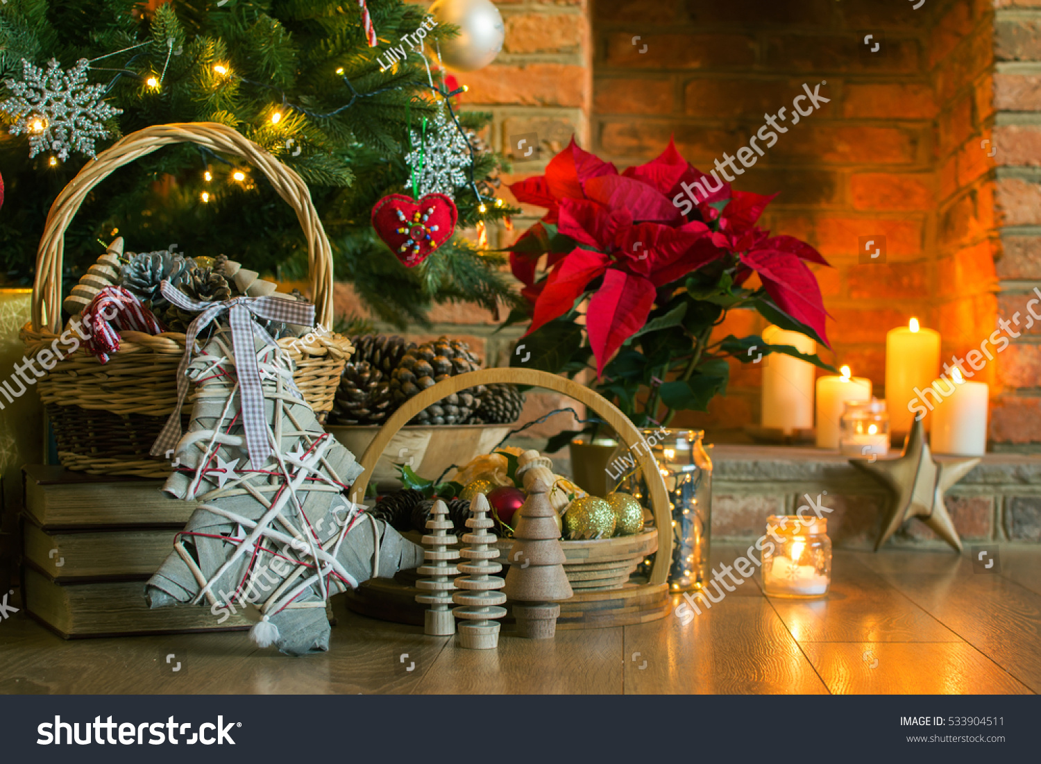 christmas setting background decorated christmas tree decorations pine cones in the basket poinsettia