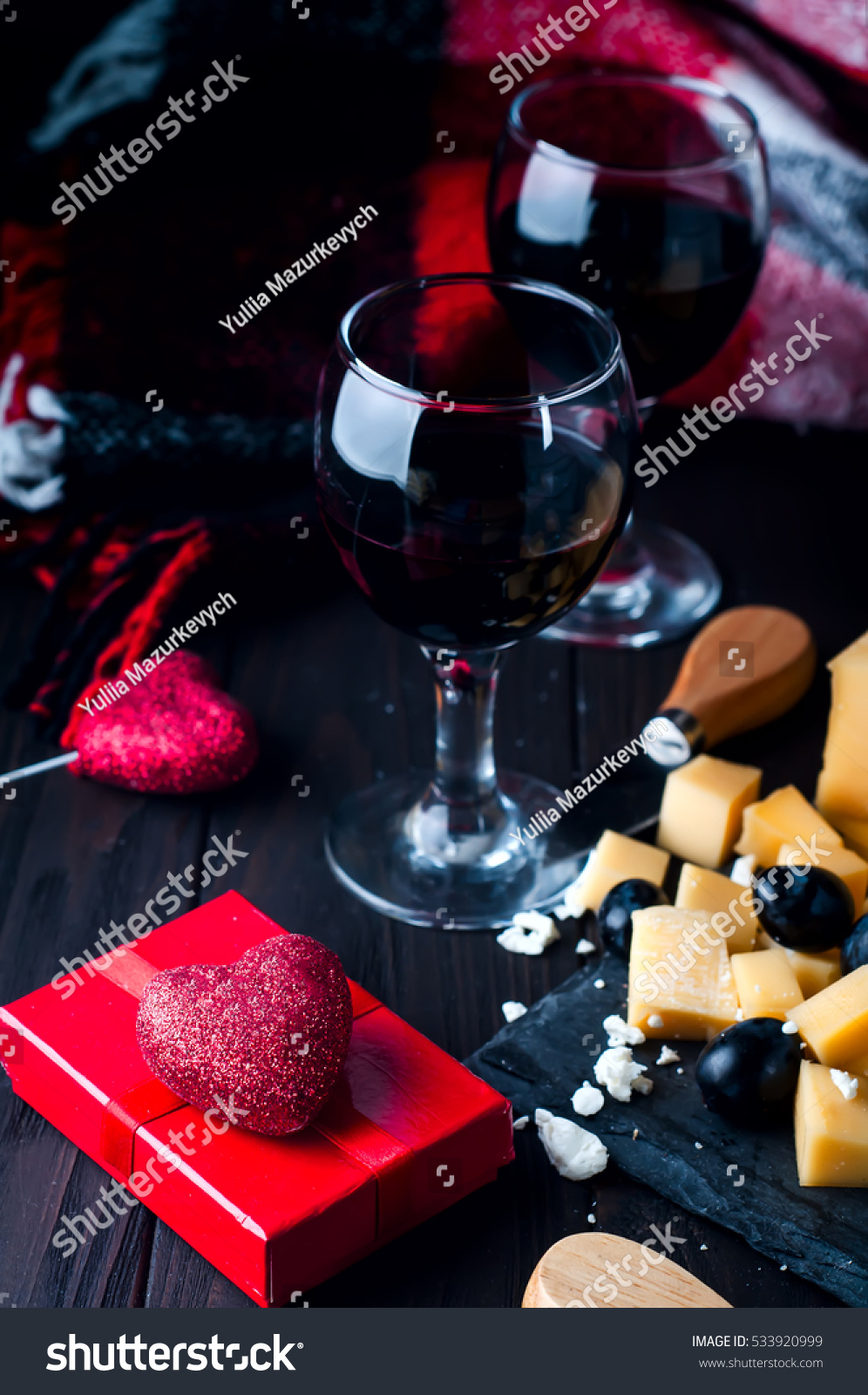 Stock photo two glasses of wine with a blanket and a heart with a gift on e38d1d44c