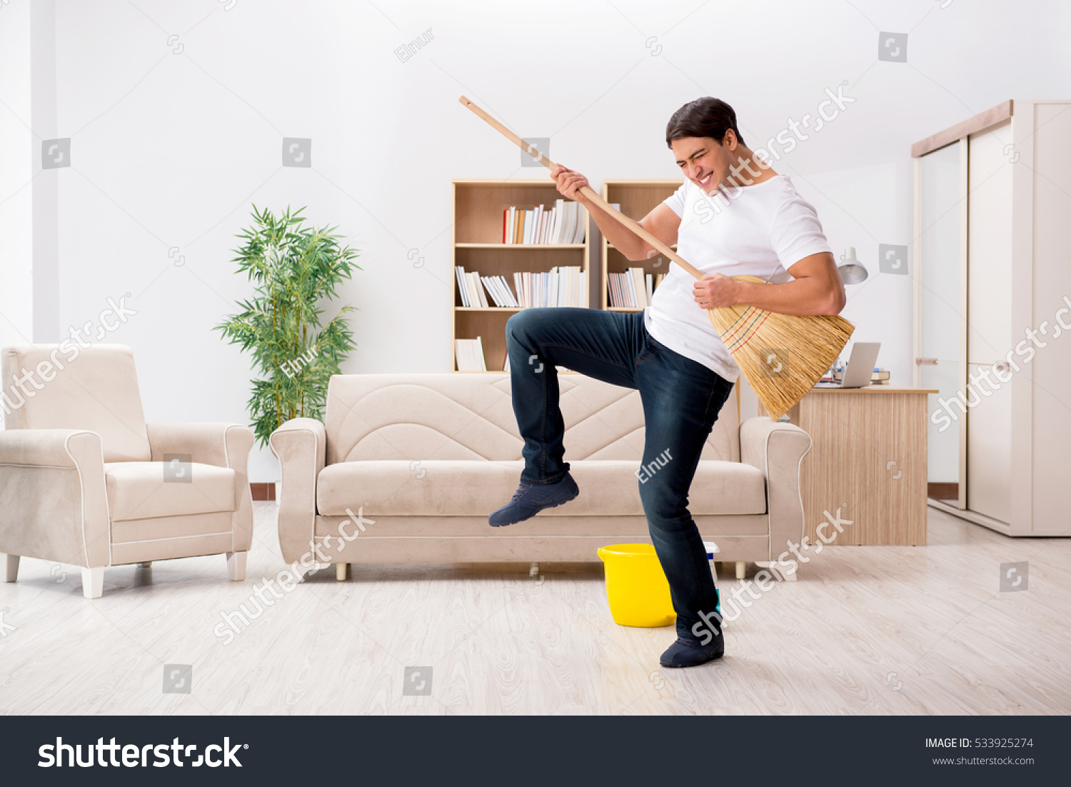 Man cleaning home broom stock photo 533925274 shutterstock for House cleaning stock photos
