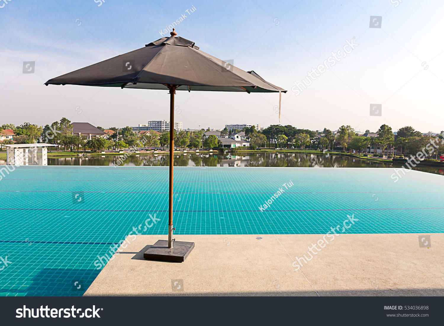 Umbrella service in upper deck swimming pool in luxury village with beautiful sky at morning. #534036898